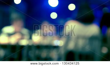 Blurred defocused of light in pub city abstract background with light leak