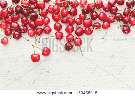 Fresh cherries. Freshly picked sweet cherries on wooden table