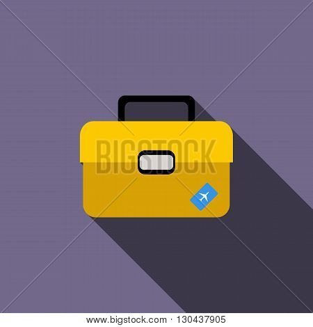 Yellow luggage icon in flat style on purple background