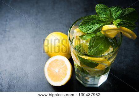 Refreshing cold lemonade, Cocktail on dark stone table