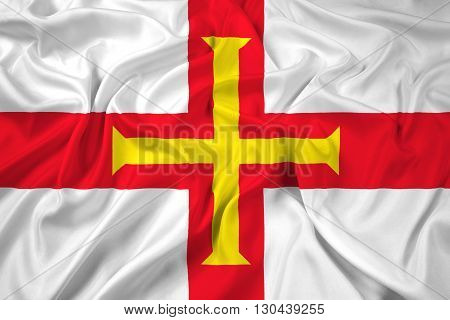 Waving Flag of Guernsey, with beautiful satin background