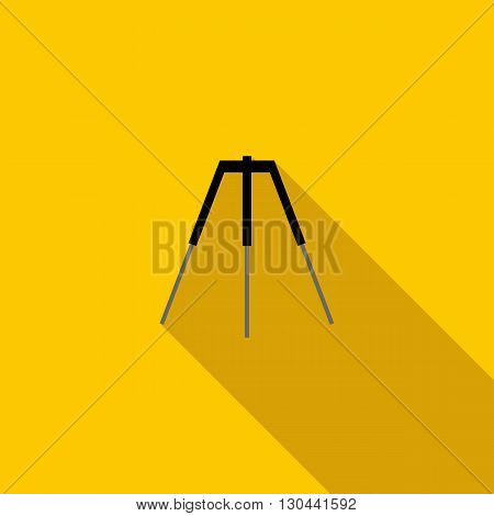 Tripod icon in flat style on a yellow background