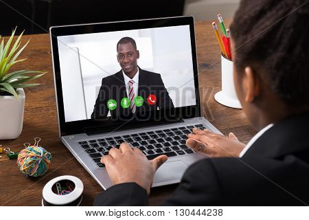 Close-up Of Businesswoman Video Conferencing With Colleague On Laptop