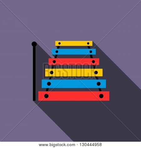 Xylophone icon in flat style on a violet background