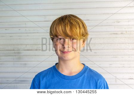 outdoor portrait of happy smiling boy with harmonic background
