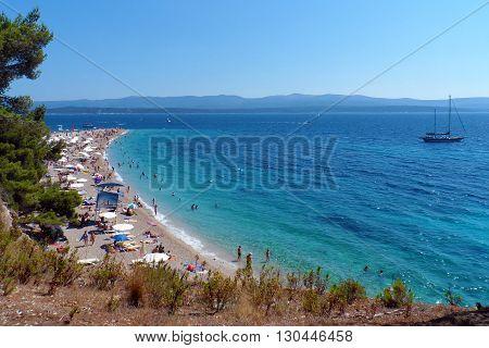 The clear blue waters of stunning Zlatni Rat Beach in Croatia