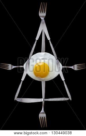 masonic symbol created from the fried egg, knifes and forks