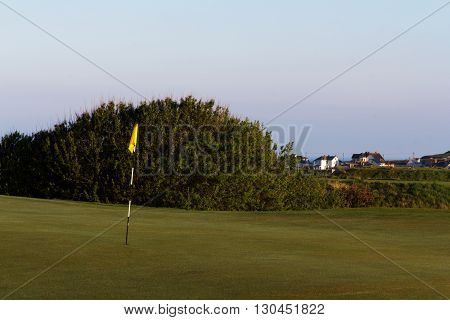 Flag On The Green At Golf Course