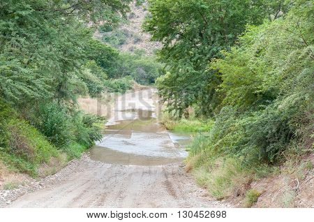 The road through the Baviaanskloof (baboon valley) crosses the Baviaans River on a concrete causeway one of many such crossings on the road
