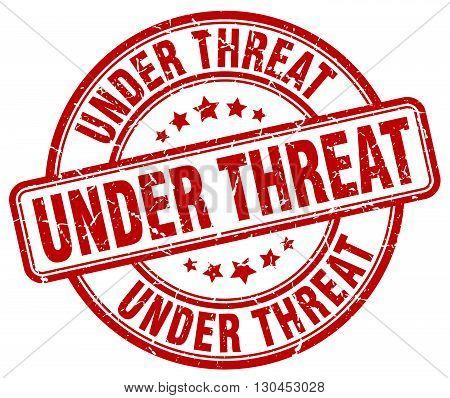 under threat red grunge round vintage rubber stamp