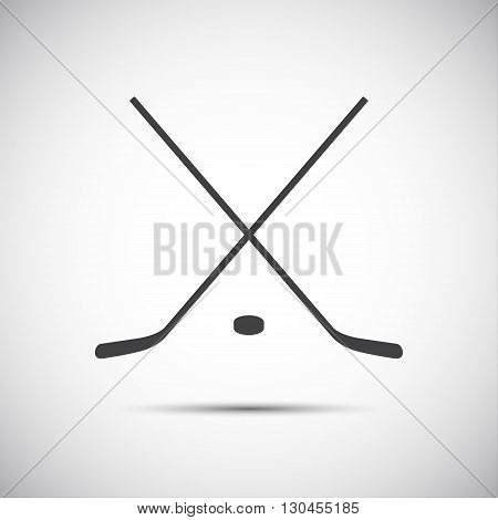 Simple crossed hockey stick with puck vector icon