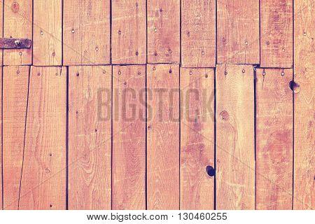 Vintage Toned Old Wooden Barn Door Background