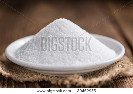 White Sugar (selective Focus) On Wooden Background