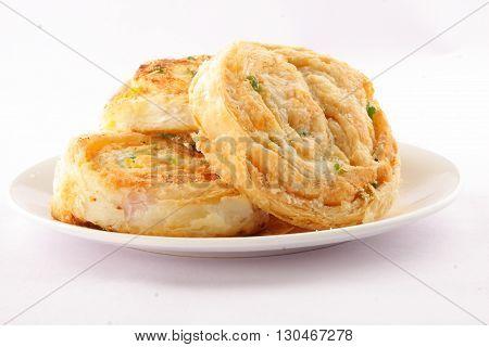 Homemade Crispy baked Sweet rolls. served in plate.