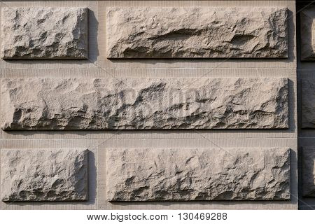 Close up of wide limestone bricks of a building wall