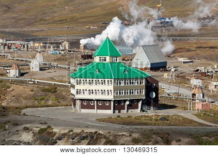 MUTNOVSKY VOLCANO KAMCHATKA PENINSULA RUSSIA - SEP 21 2011: View of hotel building for power plant personnel tourists and travelers located on territory of Mutnovskaya Geothermal Power Station.