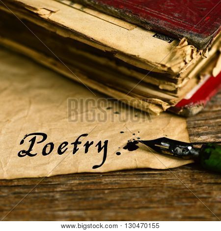 closeup of an old book, an old dip pen and a yellowish paper with the word poetry day written with black ink in it, on a rustic wooden table