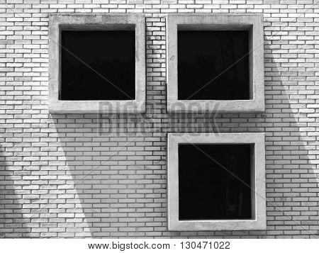 Identical square windows in a Brick Wall.
