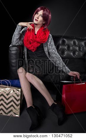 Redhead with Shopping Bags on a Black Leather Couch