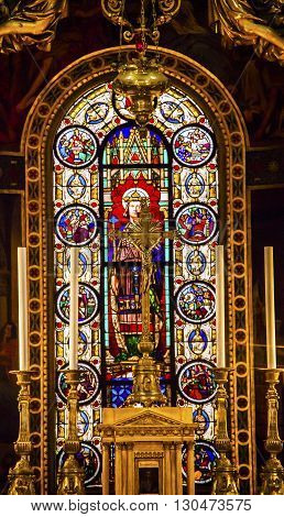 PARIS, FRANCE - MAY 31, 2015 Altar Crucifix King Louis 9th Stained Glass Basilica Saint Louis En L'ile Church Paris France. Saint Louis En L'ile church built in Notre Dame was built in 1726 on the island in back of Nortre Dame.