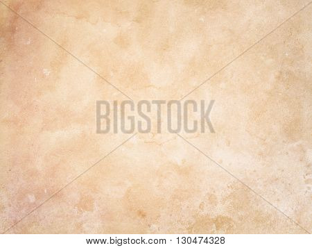 Aging paper background. Grunge paper texture for the design.