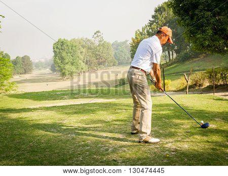 Kathmandu, Nepal - March 23 2016: An unidentified Golfer ready to shot a ball at the Royal Nepal Golf CourseKathmandu on a Sunny day.