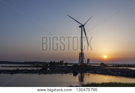 UMEA, SWEDEN ON JUNE 02. View of the harbor in sunset, power plant and the shallow coast on June 02, 2013 in Holmsund, Sweden. Nordic night during June, July and August. Editorial use.