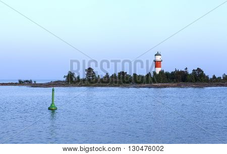 Sea marks and lighthouse in the archipelago. Navigations help in the evening on shallow water.