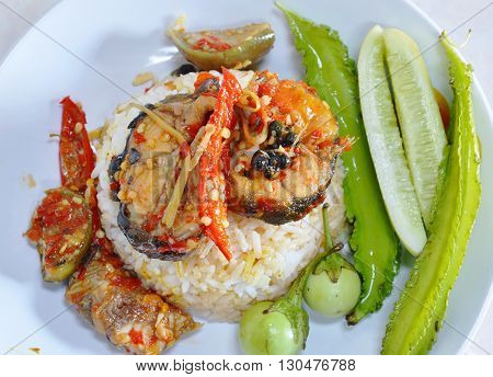 spicy stir fried catfish on plain rice
