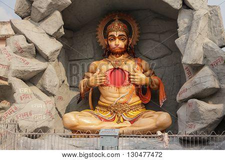 RISHIKESH INDIA - CIRCA NOVEMBER 2011 - the Hindu god Hanuman sculpture on river embankment in front of Parmarth Niketan ashram