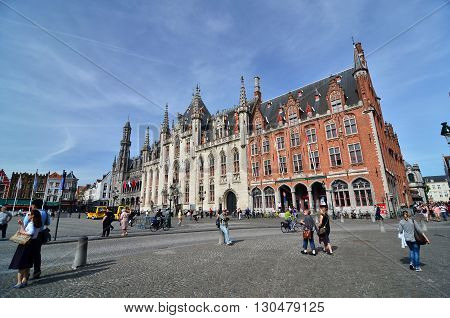 Bruges Belgium - May 11 2015: Tourist on Burg square in Bruges Belgium on May 11 2015. The historic city centre is a prominent World Heritage Site of UNESCO.