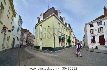 Bruges Belgium - May 11 2015: Tourists walking on street in the center of Bruges city Belgium. Bruges is the capital and largest city of the province of West Flanders in the Flemish Region of Belgium.