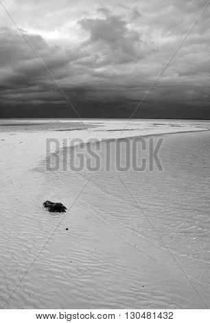 Isla Blanca Chacmuchuk Lagoon tidal beach under stormy skies