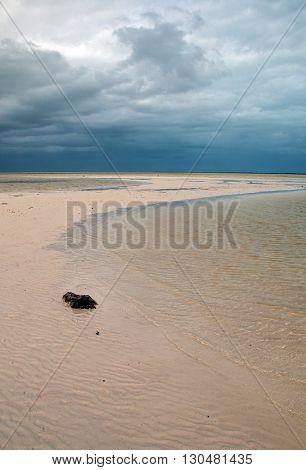 Isla Blanca tidal beach under stormy skies