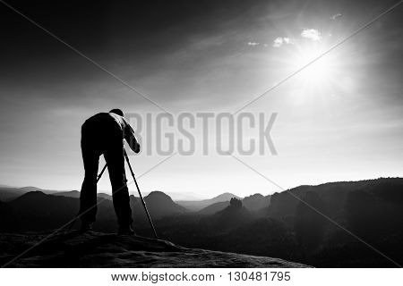 Photo Enthusiast Stay With Tripod On Cliff And Thinking. Dreamy Fogy Landscape, Blue Misty Sunrise I