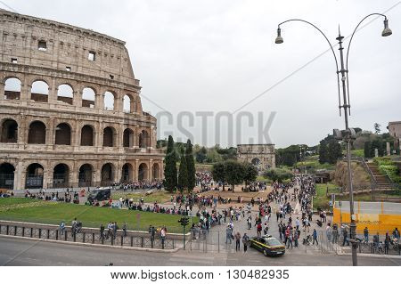 ROME ITALY - APRIL 7: Colosseum was built in the first century AD by the Emperor Vespasian. Tourists in Rome city on April 7 2016 Rome Italy.