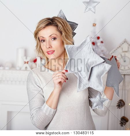 Portrait Of A Beautiful Woman In The Interior With Christmas Decorations