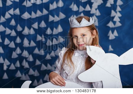 Little Girl In Christmas Decorations. Portrait Of Beautiful Little Girl With Long Blond Hair With Cr