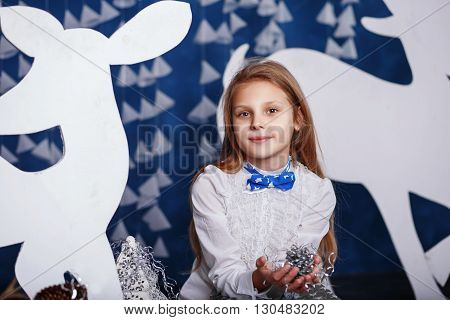 Little Girl With Bow-tie In Christmas Decorations.