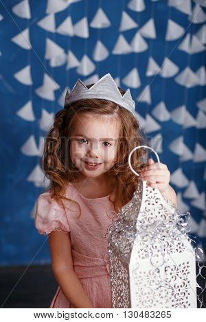 Little Girl In Christmas Decorations. Portrait Of Beautiful Little Girl With Long Curly Hair With Cr