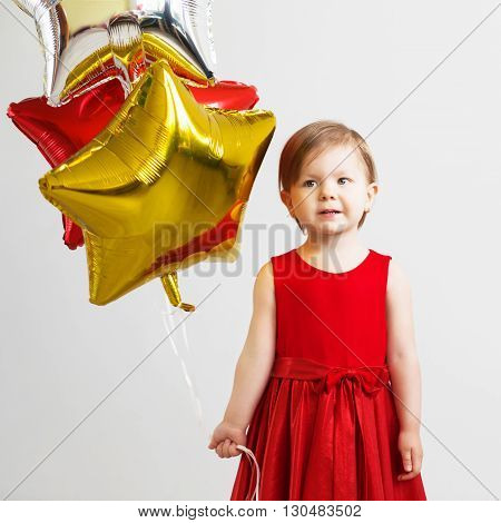 Happy Child With Colorful Shiny Foil Balloons