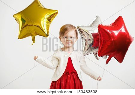 Little Baby Girl  With Colorful Shiny Foil Balloons Against A White Background