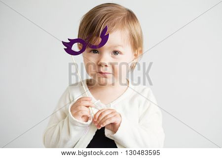 Portrait Of A Lovely Little Girl With Funny Cardboard Glasses