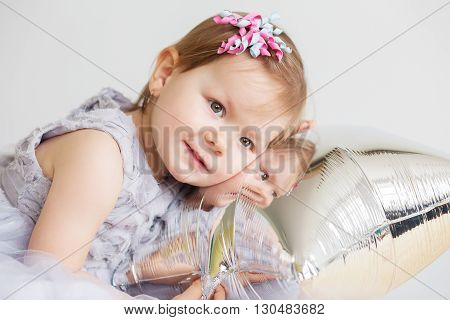 Baby Girl Playing With Silver Star-shaped Balloon.