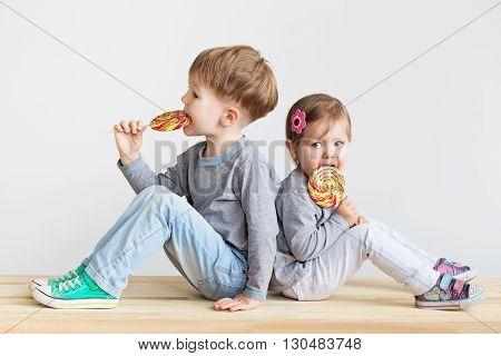 Little Children Eating Lollipops