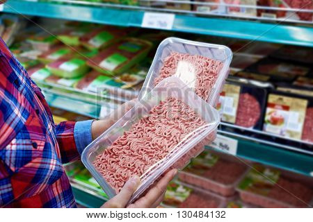 Buyer Chooses Minced Meat In Store