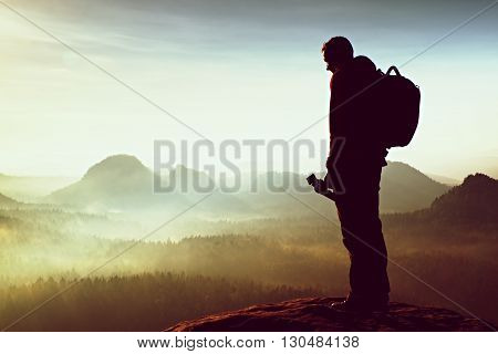The Photographer Think About Picture At Sunset In The Misty Mountains