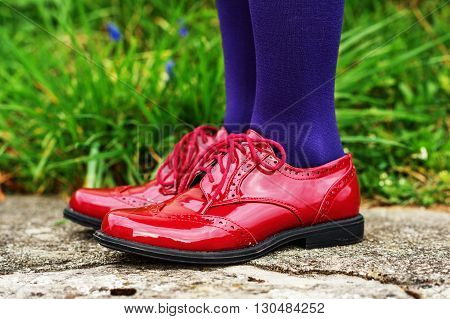 Fashion red brogues shoes on kid's feet