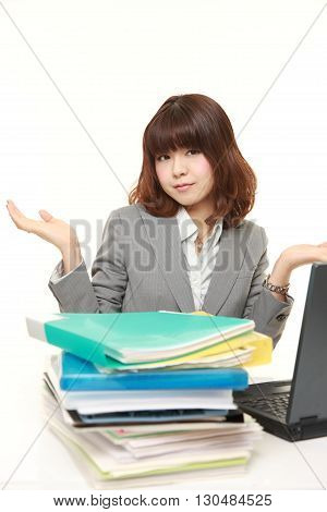 portrait of businesswoman shrinks from overtime work on white background