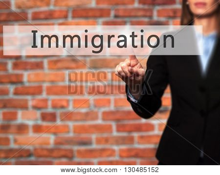 Immigration - Businesswoman Hand Pressing Button On Touch Screen Interface.